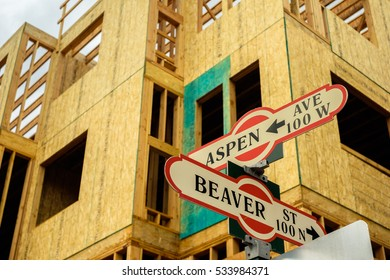 Cityscape view of Aspen Avenue and Beaver street signs with new building construction in Flagstaff, Arizona.