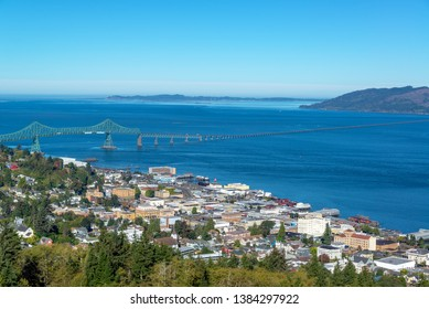 Cityscape view of Astoria, Oregon with the Astoria Megler Bridge and Columbia River