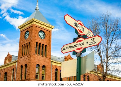 Cityscape view of Birch Avenue and San Francisco street signs with clock tower in Flagstaff, Arizona.