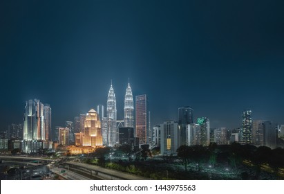 Cityscape view in the middle of Kuala Lumpur city center , night time , Malaysia .