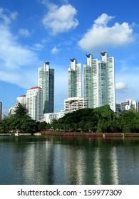 Cityscape view of modern buildings at Benjakitti garden at dusk in Bangkok, Thailand