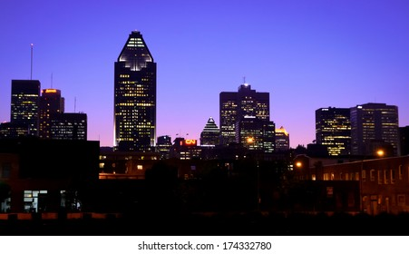 Cityscape view of Montreal at blue hour time.  Silhouette buildings.