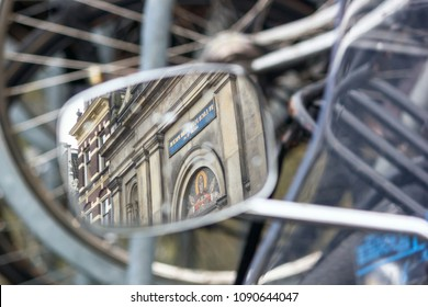 Cityscape - view on the Christian church in Amsterdam, reflection in a side mirror of motorcycle, The Netherlands, January 2, 2018