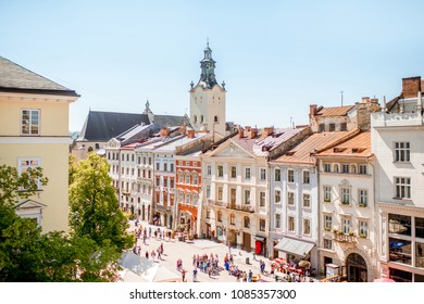 Cityscape view on the old town with beautiful buildings and tower of Latin cathedral during the sunny weather in Lviv city in Ukraine