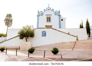 Cityscape view on the old town with saint Anna church in Albufeira city on the south of Portugal