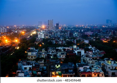 Cityscape view of one of the most important streets of Noida at night. Shows the huge expanse of Noida city, the housing and office spaces