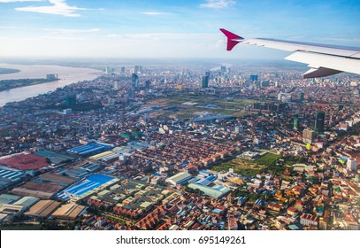 The cityscape view of Phnom Penh City from the window of airplane