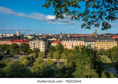 Cityscape view of Stockholm from above with trees and buildings.