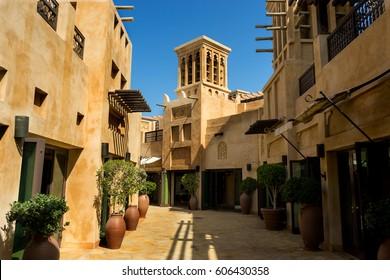A cityscape view of a street in open arabian style market in summer, Dubai, UAE.