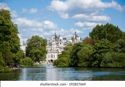A cityscape view through the Serpentine lake in Hyde Park, Kensington Gardens in sunny day. London UK.