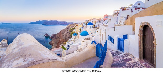 Cityscape of the village of Oia in the Santorini Island, Greece. Santorini is an ancient volcano located in the middle of the mediterranean sea, surrounded by crystalline and refreshing waters.