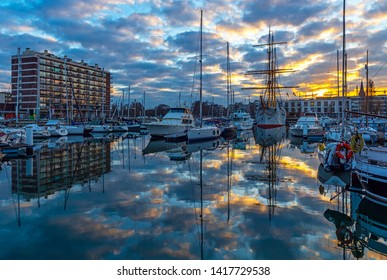 Cityscape of the yacht marina harbor at sunset in the city center of Ostend by the North Sea, Belgium.