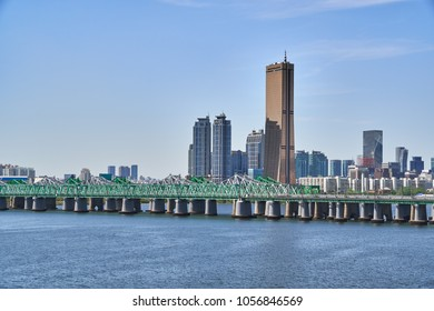 Cityscape of Yeouido in Seoul, with Hangang railway bridge, Han-river and 63 building.