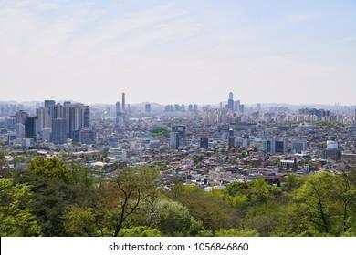 Cityscape of Yongsan-gu and Mapo-gu with Wonhyo bridge and Yeoui-do island in Seoul, Korea. The view is from N tower in Namsan Mountain.