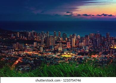Cityscapes of Honolulu city and Waikiki beach in night time at Tantalus lookout , Honolulu, Oahu island, Hawaii