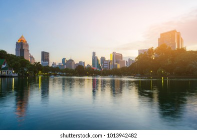 cityscapes of modern building at sunset with gorgeous skyline and water reflection. attractive beautiful travel city park in Bangkok Thailand.