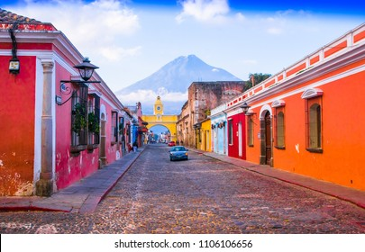 Ciudad de Guatemala, Guatemala, April, 25, 2018: Cityscape in the main street of Antigua city with the Agua volcano in the background