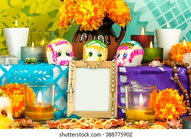 CIUDAD DE MEXICO, CDMX / MEXICO- OCTOBER 31 2015: Traditional day of the dead altar with sugar skulls and candles. Festivity celebrated throughout Mexico in October 31, November 1 and November 2