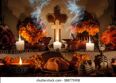 CIUDAD DE MEXICO, CDMX / MEXICO- OCTOBER 31 2015: Traditional day of the dead altar with pan de muerto and candles. Festivity celebrated throughout Mexico in October 31, November 1 and November 2