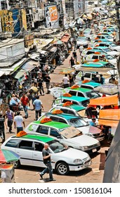 CIUDAD DEL ESTE, PARAGUAY - DECEMBER 13: Typical crowd of taxis in downtown on December 13, 2011 in Ciudad Del Este. The city is known for its free trade area and the usual mess and crowd.