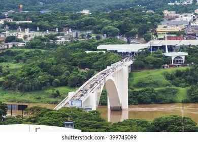 Ciudad del Este, Paraguay - December 5: Aerial view of traffic crossing the Friendship Bridge (Ponte da Amizade), connecting Foz do Iguacu, Brazil, to Ciudad del Este in Paraguay.