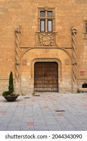 CIUDAD RODRIGO, SPAIN - MARCH 05, 2021: Montarco Palace in Conde square in the old town of Ciudad Rodrigo illuminated at night, Salamanca, Castilla y León, Spain.