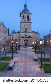 CIUDAD RODRIGO, SPAIN - MARCH 06, 2021: Cathedral of the city of Ciudad Rodrigo and Cerralbo church illuminated at night, Salamanca, Castilla y León, Spain.