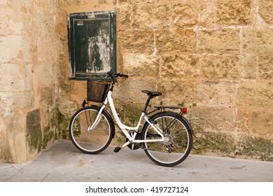 CIUTADELLA / BALEARIC ISLANDS, SPAIN - MARCH 27, 2016: A bike in the downtown of Ciutadella. Minorca, Balearic Islands