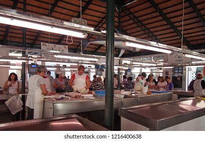 Ciutadella, Menorca, Spain - 28 October 2018: Workers and shoppers at the fish market in Ciutadella Menorca