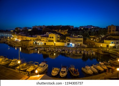 CIUTADELLA IN MENORCA, SPAIN - JUNE 30th, 2018: view of the old harbour during blue hour