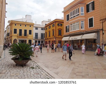 Ciutadella, Menorca / Spain - October 1 2018: Tourists and shoppers walking in the street in Ciutadella Menorca town center.