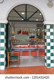 Ciutadella, Menorca, Spain - September 29 2018: A traditional meat shop in the old Ciutadella town market with a sign advertising quality meat and products in spanish