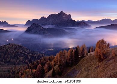 Civetta mountain above night inversion cover, Dolomites, Italy