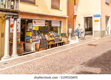 Cividale del Friuli, Italy - Aug 14 2018: Tourist street deli shop with traditional Italian products in Cividale del Friuli, Italy offering wine, sweets and meat products to tourists