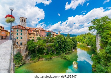 Cividale del Friuli - June 2017, province of Udine, Italy: View of the old city center with traditional architecture. River Natisone with transparent water. Summer day and blue sky with clouds.