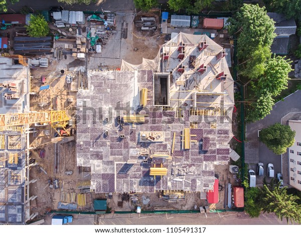 civil construction site in old neighbourhood of city viewed from above