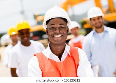 Civil engineer at a building site wearing a helmet