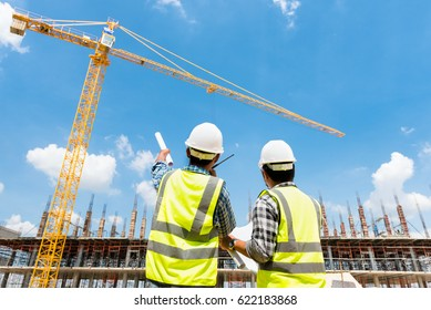 Civil engineer checking work with walkie-talkie for control and management in the construction site or building site of highrise building