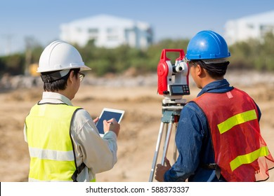 Civil engineer concept ; Asian construction engineer and Asian civil engineer checking construction site for new Infrastructure project,Construction engineer checking construction by tablet.
