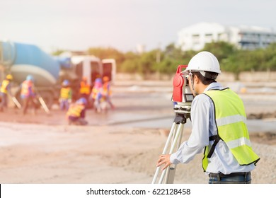 Civil engineer concept ; Asian civil engineer working with his equipment at infrastructure site project