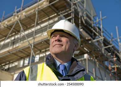 Civil Engineer With Construction Site In Background.