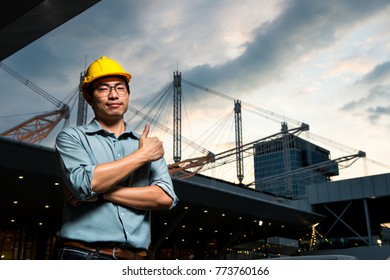 Civil Engineer With Construction Site In Background at twilight time in the evening.
