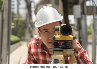 Civil engineer land survey with tacheometer or theodolite equipment. worker Checking construction site on the road. Surveyor engineer making measuring with theodolite instrument level tool.