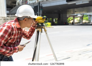 Civil engineer land survey with tacheometer or theodolite.