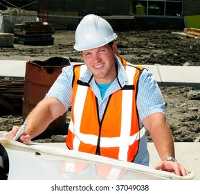 Civil Engineer Looking At The Plans To A Construction Site On The Hood Of His Car