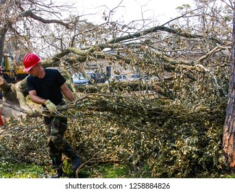 Civil Engineer pulls branches felled by Hurricane Katrina at Keesler Air Force Base, MS. Taken on August 16, 2005.