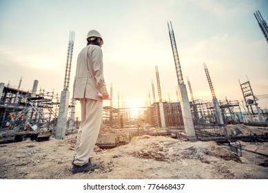 Civil engineer and safety officer in spec steel truss structure scaffolding risk analysis in construction site