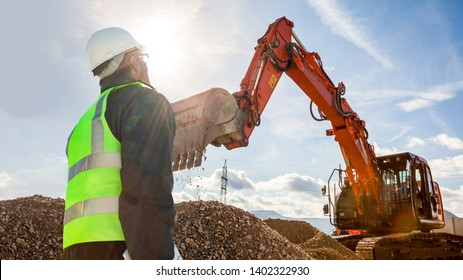 civil engineer worker on consstruction site with excavator machine