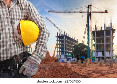 civil engineer working in building construction site and sunset sky with crane construction