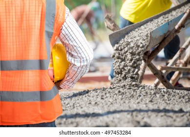 Civil Engineering check a Concrete pouring during commercial concreting floors of building